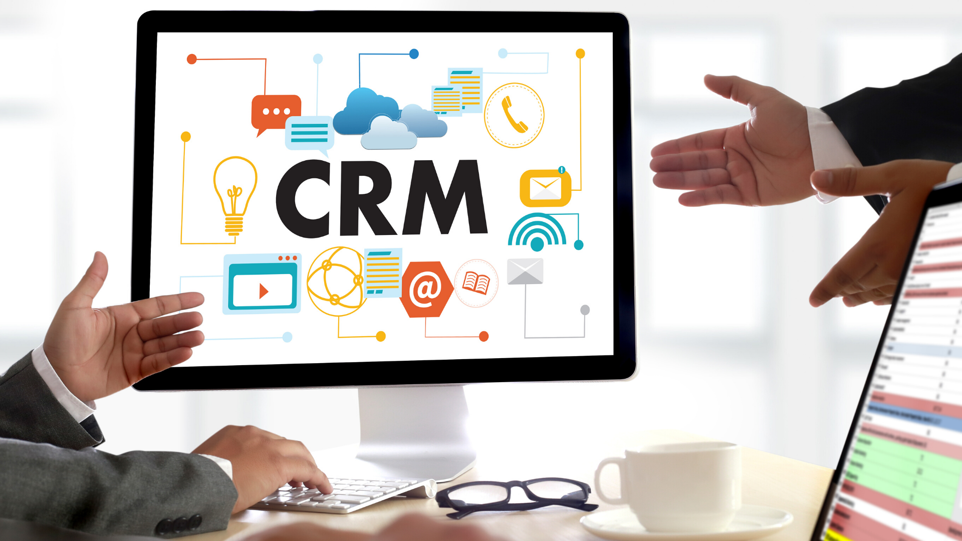 Image of business people around computer displaying the word CRM