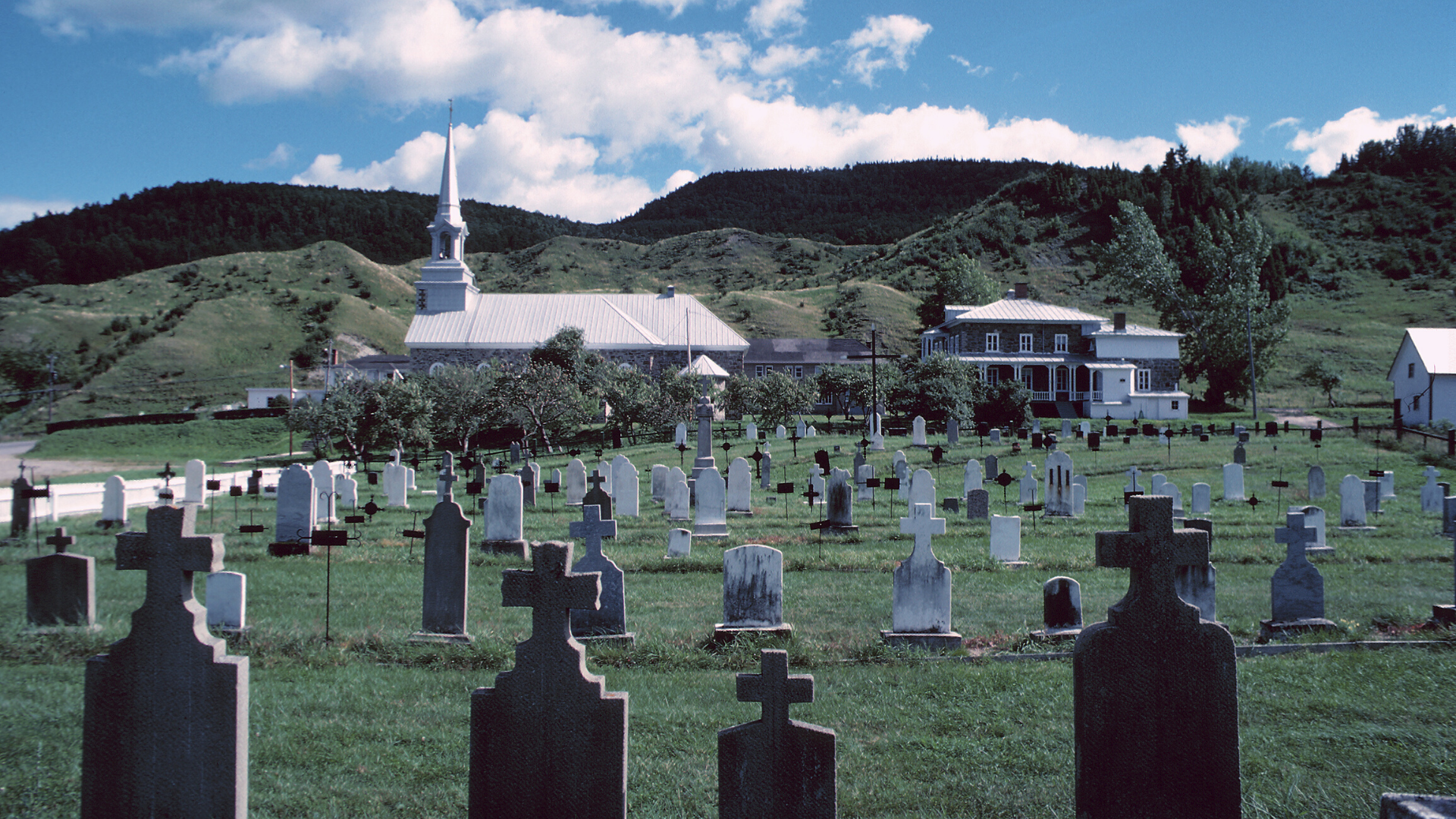 Photo of a Catholic church and cemetery