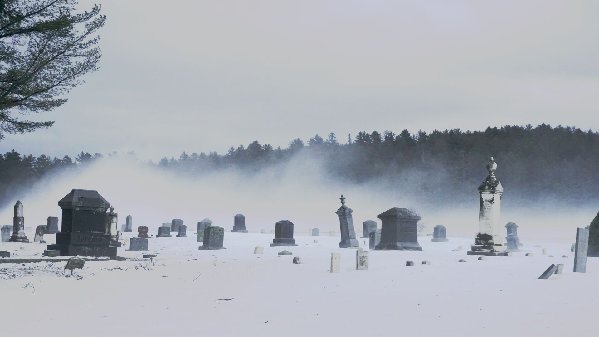 Photo of a cemetery under snow