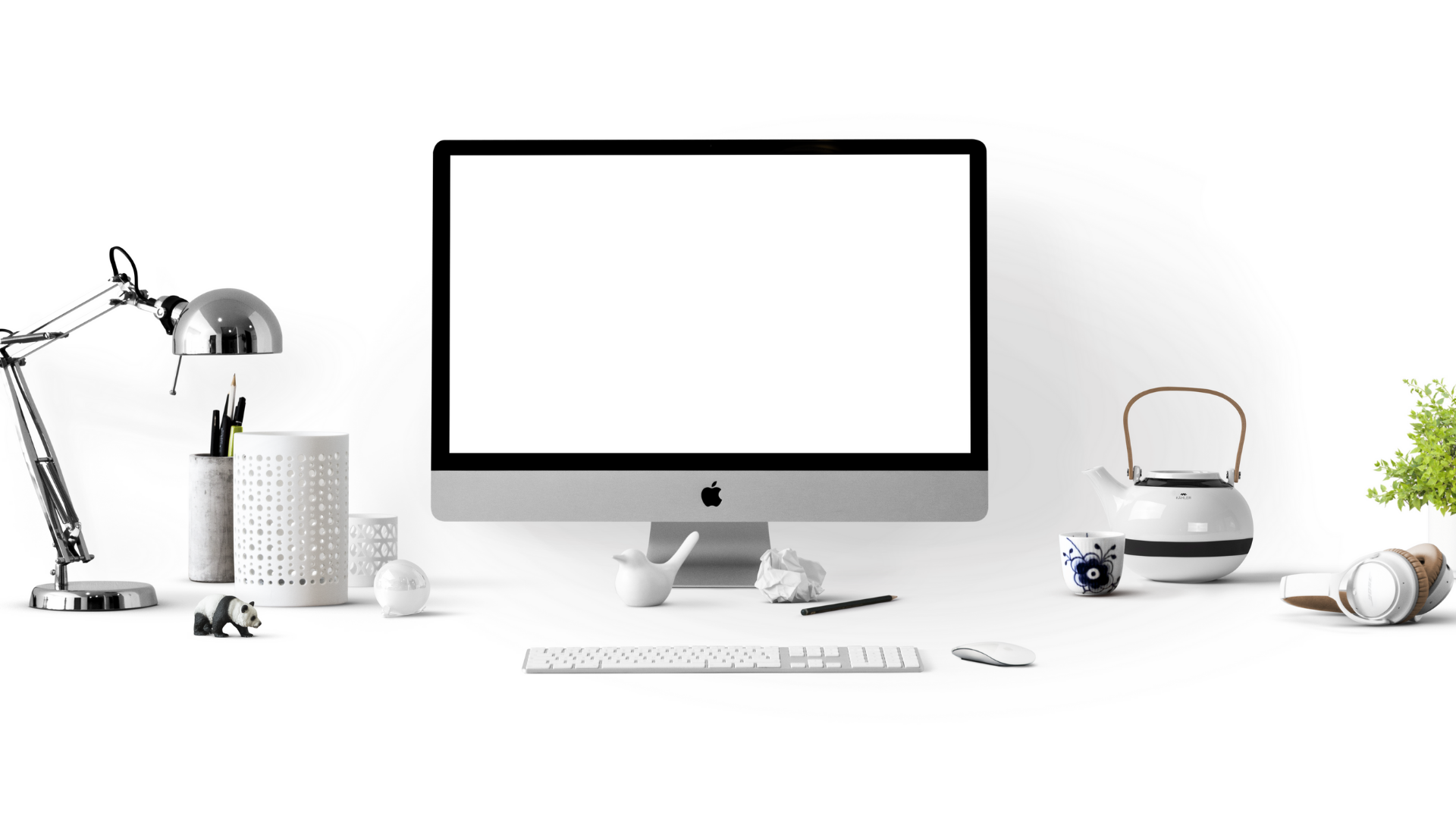 Photo of a computer on a minimal white desk