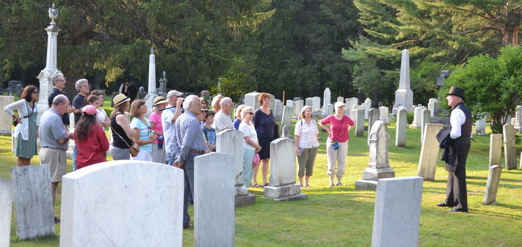 Photo of a tour taking place in a sunny cemetery