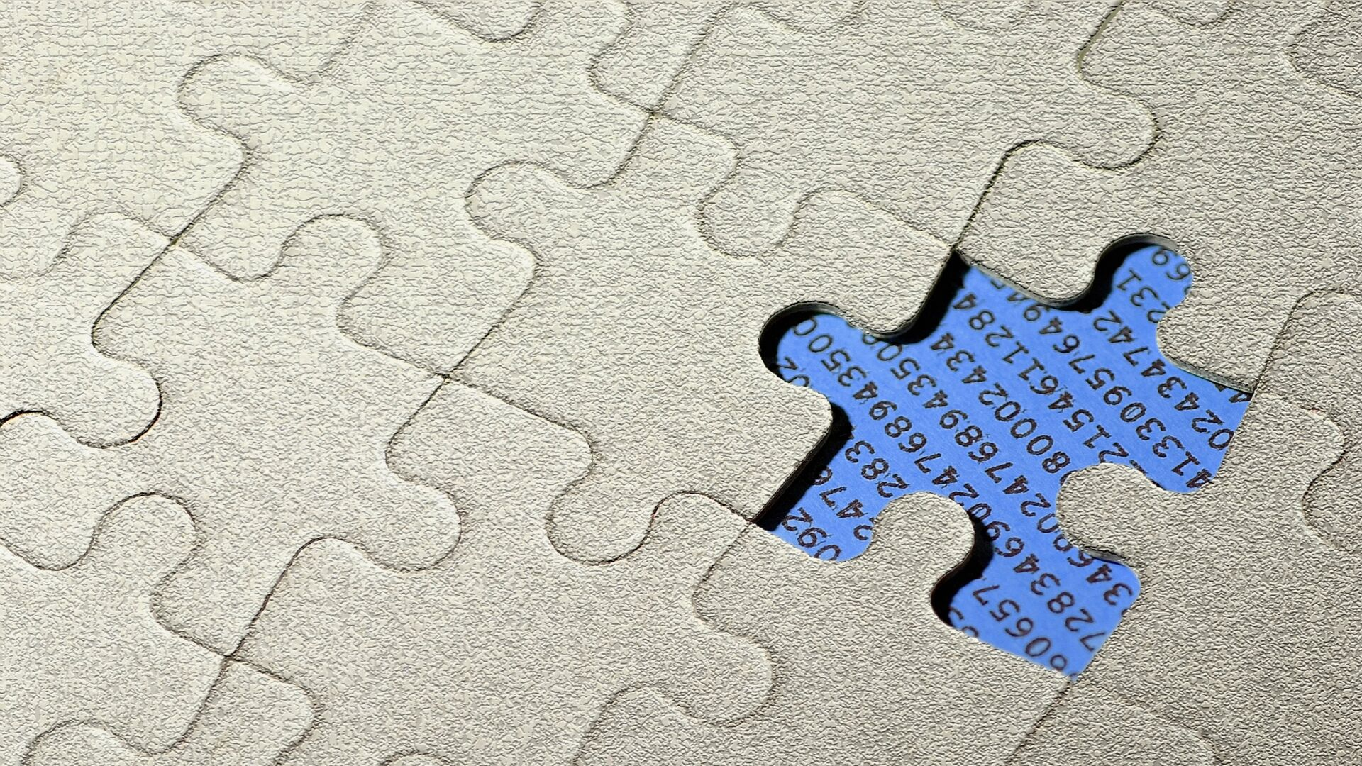 Image of a jigsaw with one piece missing
