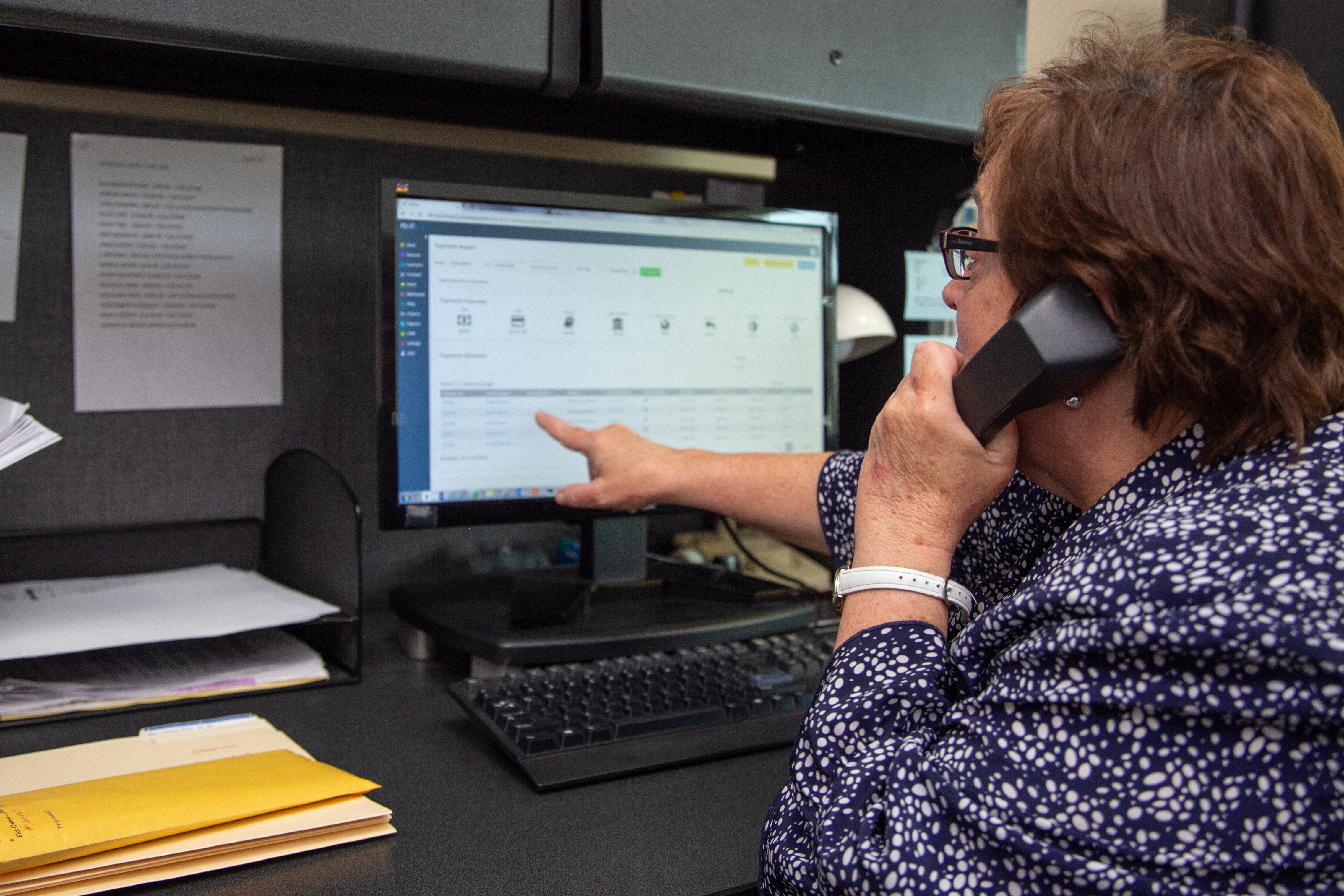 Photo of cemetery office staff using PlotBox
