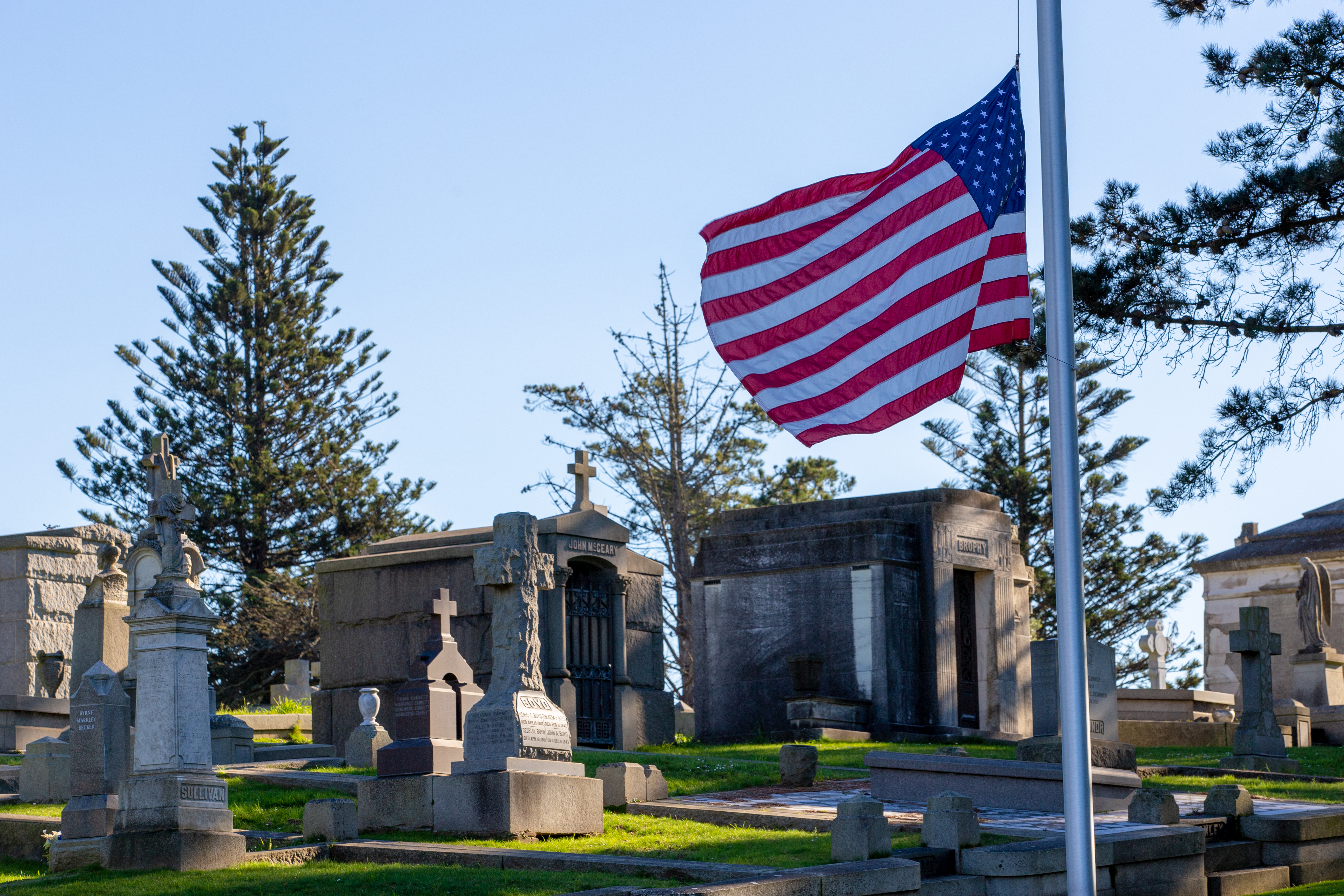 Photo of an American flag in a cemetery