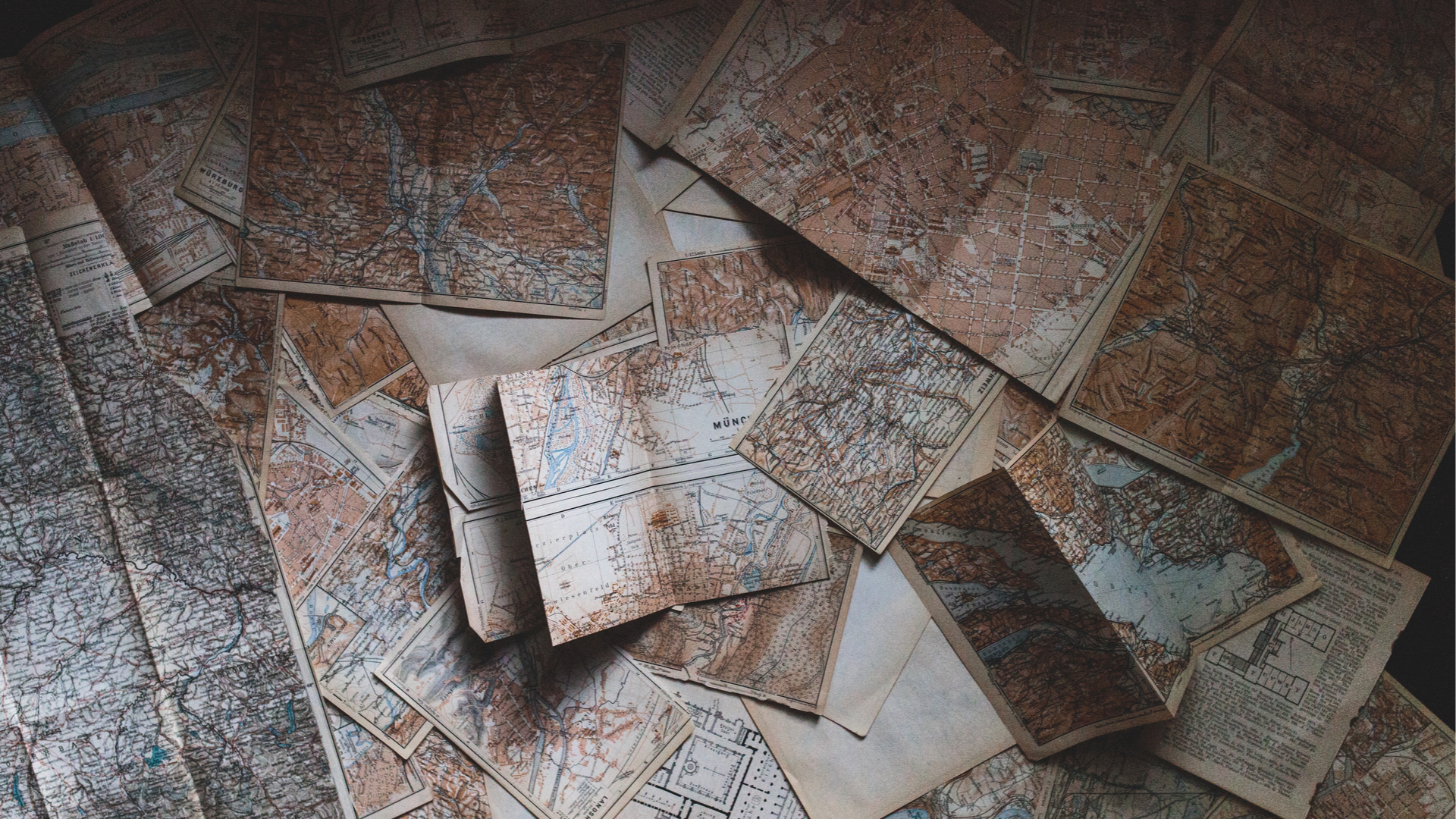 Image of a bunch of old maps on a table