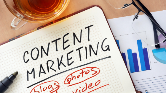 Image of notebook with content marketing written on it