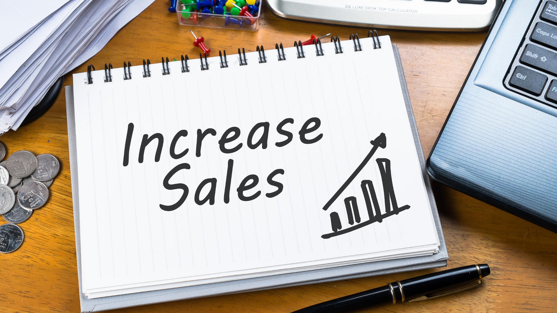 Image of the words 'increase sales' on a notebook