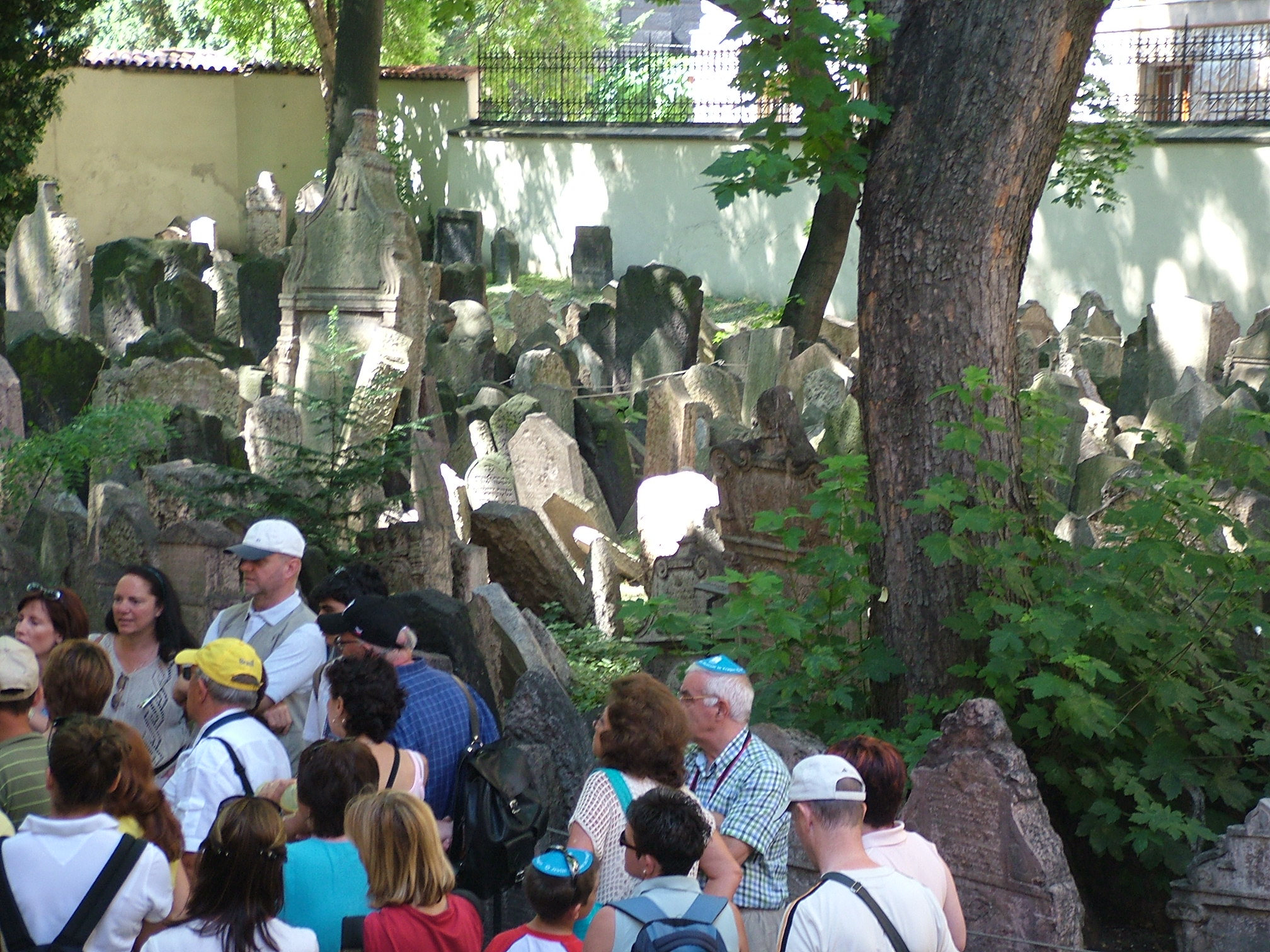 Photo of group of tourists in a graveyard