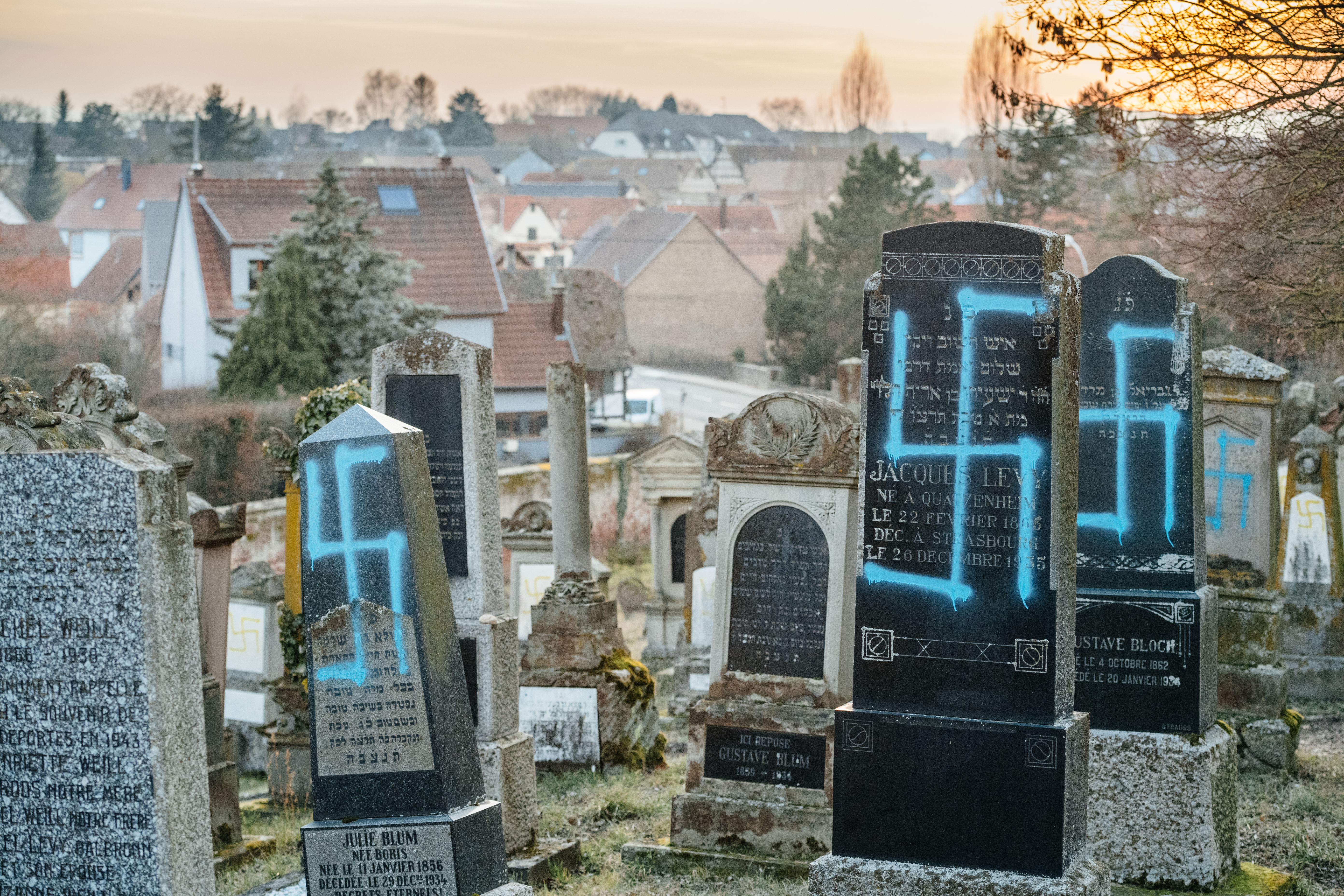Photo of headstones vandalised with spray paint