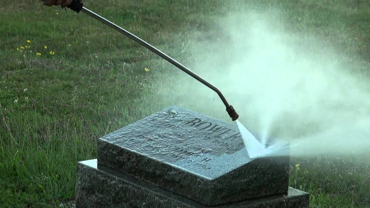 Photo of a headstone being power hosed
